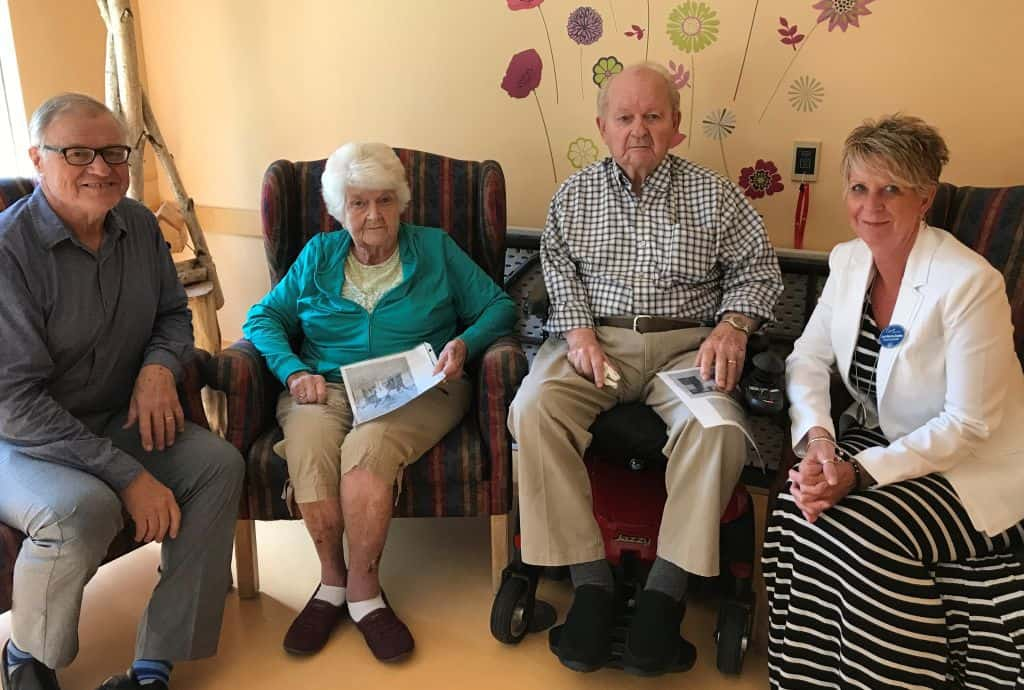 Caption: New Director of Giving John Bouza is introduced to Osgoode Care Centre residents Cecil and Charlotte Reaney by Lori Norris-Dudley, Executive Director. Mr. Reaney was a volunteer leader of the original building campaign in the mid-1980s. Photo credit: TOCC